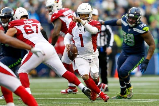 Dec 22, 2019; Seattle, Washington, USA; Arizona Cardinals quarterback Kyler Murray (1) looks to pass against the Seattle Seahawks during the second quarter at CenturyLink Field. Mandatory Credit: Joe Nicholson-USA TODAY Sports
