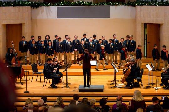 Herbert Washington, the director of the Phoenix Boys Choir, conducts the choir's holiday concert Dec. 14 at Camelback Bible Church in Phoenix.
