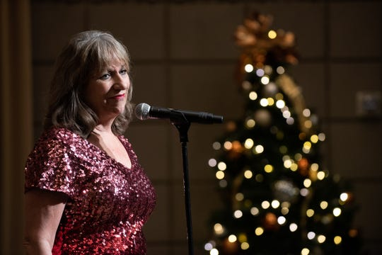 """Karina Bland tells her story during the Arizona Storytellers Project presents the """"Holiday Spectacular"""" at the Arizona Biltmore in Phoenix on Dec. 19, 2019."""