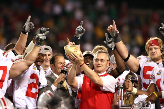 Jan. 2, 2006; Tempe, AZ USA; Ohio State Buckeyes head coach Jim Tressel holds the Fiesta Bowl trophy after the Buckeyes defeated the Notre Dame Fighting Irish 34-20. Mandatory Credit: Photo By Matt Cashore-USA TODAY Sports Copyright (c) 2006 Matt Cashore