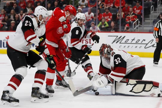 Arizona Coyotes goaltender Antti Raanta (32) falls on the puck hit by Detroit Red Wings left wing Justin Abdelkader (8) during the first period of an NHL hockey game, Sunday, Dec. 22, 2019, in Detroit. (AP Photo/Carlos Osorio)