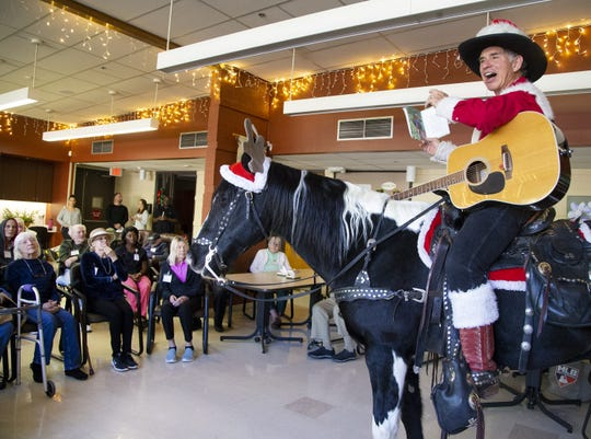 Gary Sprague and his horse, Dusty, perform during a holiday program at Desert Mission Adult Day Health Center in Phoenix on Dec. 13, 2019.