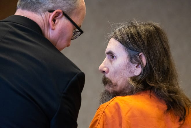Louis Woodard, right, confers with his attorney at the podium during a sentencing hearing Monday, Dec. 23, 2019, in the St. Clair County Courthouse. Woodard plead guilty in St. Clair County to felon in possession of a firearm, felon in possession of ammunition and three counts of child sexually abusive material.