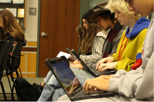 Journalism students at Susquehannock High School take notes during a mock press conference on Dec. 13, 2019.
