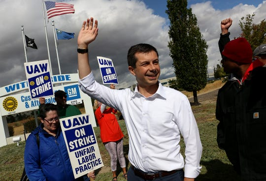 Mayor of South Bend, Indiana and candidate for president Pete Buttigieg waves while visiting with striking UAW workers in Reno on Sept. 28, 2019.