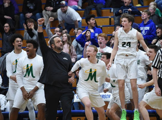 The Miners celebrate a last second score to beat Reed in the Northern Region Championship playoff game at Carson High School on Feb. 21, 2019.