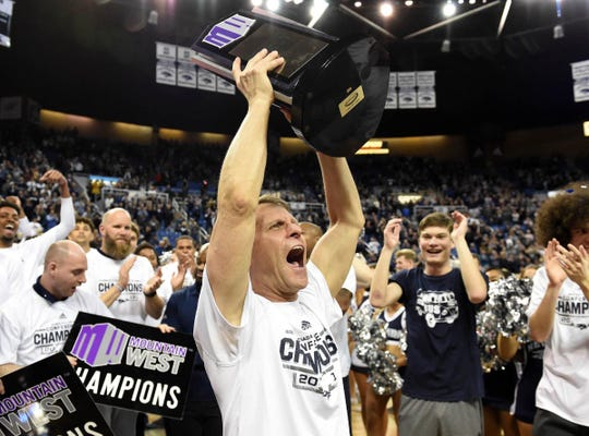 Nevada coach Eric Musselman celebrate his conference championship after defeating San Diego State at Lawlor Events Center on March 9, 2019.
