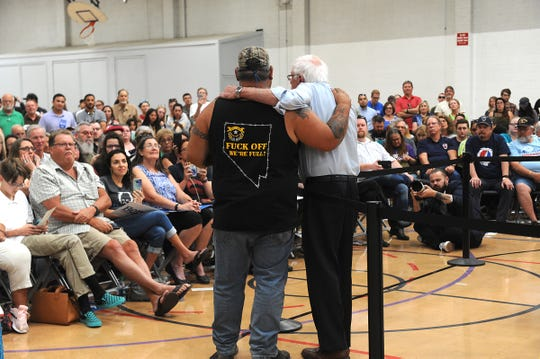 U.S. Senator and presidential candidate Bernie Sanders, right, interacts with Trump supporter Bill Herron during a campaign stop at the Carson City Community Center Gymnasium in Carson City, Nevada on Sept. 13, 2019.