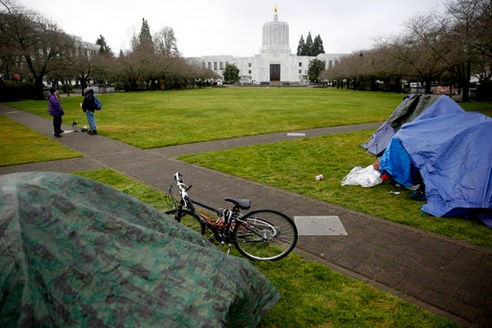 Tents and tarps are set up as about 25 homeless people camp on the Oregon State Capitol Mall in Salem on Dec. 23, 2019. A no-camping ordinance on city property went into effect last week.