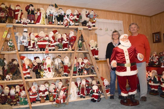 Nelson and Jan Donovan, of Georgetown, stand among 500-plus Santas they've amassed in their home.