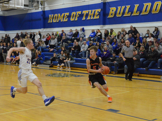 Logan Ellingson of Dell Rapids drives to the basket against Baltic's Brodee Teveldal on Monday, Dec. 16, 2019.