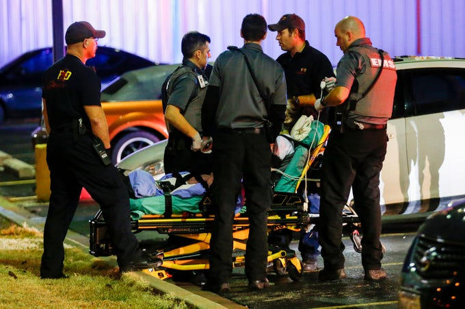 Firefighters and EMT's treat a woman who had overdosed on opioids in a Walgreens parking lot on Tuesday, Nov. 26, 2019.