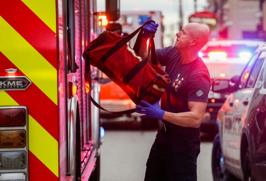 A firefighter puts away a medical bag after responding to a possible opioid overdose at a downtown business on Thursday, Dec. 5, 2019.