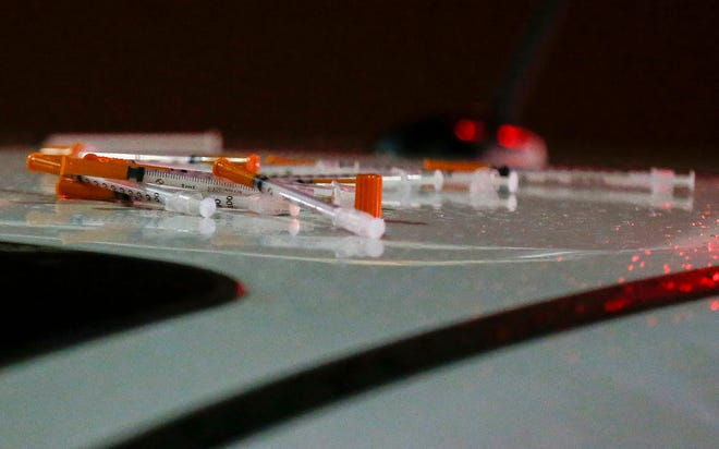Police removed nearly a dozen hypodermic needles from the car of a woman who had overdosed on opioids in a Walgreens parking lot on Tuesday, Nov. 26, 2019.