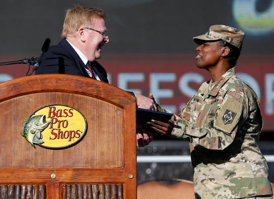 """Springfield Mayor Ken McClure presents a proclamation to Maj. Gen. Donna Martin during a rally at the """"Home for the Holidays"""" event at Bass Pro Shops on Monday, Dec. 23, 2019. Soldiers, Marines, and Airmen from Fort Leonard Wood who weren't able to go home for the Holidays were welcomed to Springfield for a rally and other activities throughout the day."""
