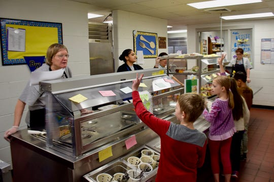 Students file through the lunch line at Bessie Weller Elementary School on Dec. 4, 2019.