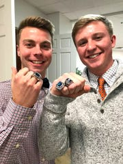 Kyle Stenzel and Thomas Otteni show off their state championship rings they earned for being part of the Robert E. Lee High School soccer team last season.