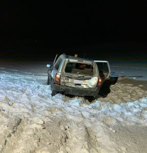 A U.S. Post Office vehicle was struck from behind by another vehicle while stopped at a mailbox Friday, December 20 near Albany.