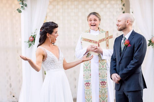 Darcy Ward reacts at her wedding coin toss that determined Jeff, her groom, will take on her last name.