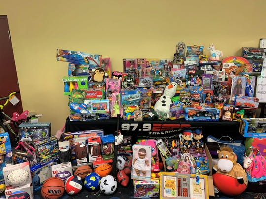 The Jeff Cameron Holiday Bowling Tournament at Capital Lanes was the site of a massive toy drive. These gifts were collected for kids linked to Guardian ad Litem.