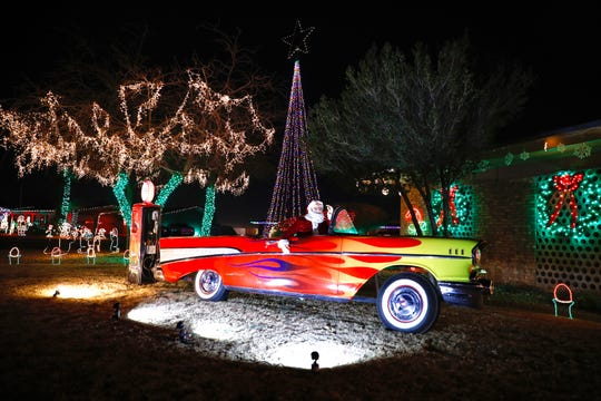 A model Chevy vehicle from 1957 and Santa are one of dozens of decorations at Victor Hernandez's house in the Eastridge neighborhood.
