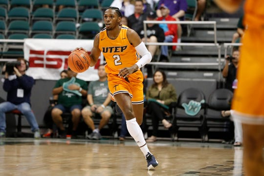 UTEP guard Jordan Lathon (2) takes the ball down court against Hawaii during the first half of an NCAA college basketball game Sunday, Dec. 22, 2019, in Honolulu. He has decided to stay with the team.