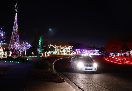 Eastridge residents continue their holiday traditions decorating their homes with lights and inviting El Pasoans to come and see.