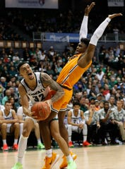 Hawaii guard Samuta Avea (32) gets fouled by UTEP guard Anthony Tarke (3) during the second half of an NCAA college basketball game Sunday, Dec. 22, 2019, in Honolulu. (AP Photo/Marco Garcia)
