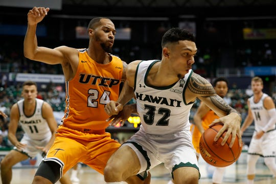 UTEP guard Daryl Edwards (24) guards Hawaii guard Samuta Avea (32) during the first half of an NCAA college basketball game Sunday, Dec. 22, 2019, in Honolulu. (AP Photo/Marco Garcia)