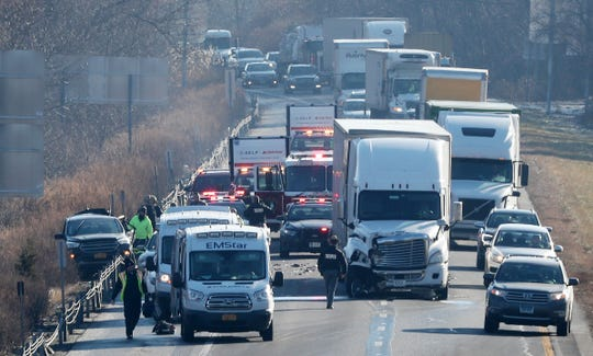 Traffic crawls by the scene of a crash involving a tractor-trailer and two cars on westbound Interstate 84 just east of Interstate 684 in the town of Southeast on Dec. 23, 2019. The injuries were non-life threatening and traffic westbound was backed up for miles.