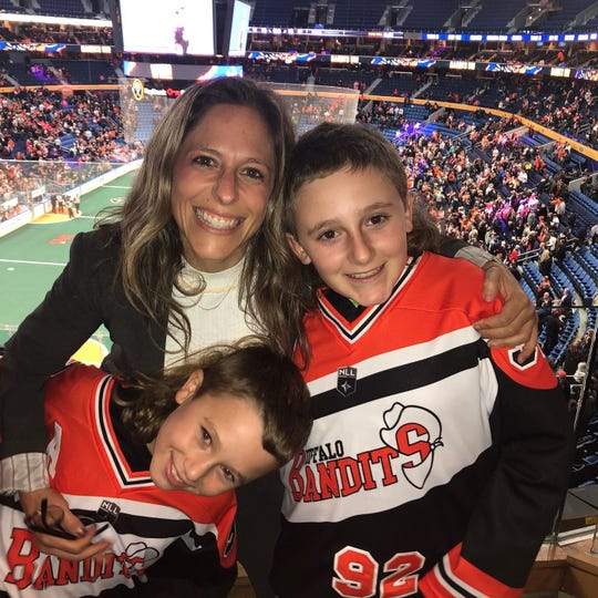 Jesscia Berman with her kids Noah, 11, and Andrew, 9, at a Buffalo Bandits v San Diego Seal game in December 7, 2019.