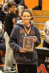 Horace Greeley senior Isabella Garcia poses with the Most Outstanding Wrestling plaque.