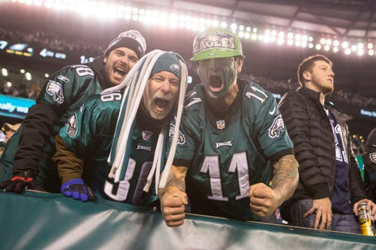 Eagles fans celebrate a late fourth down stop in the fourth quarter Sunday night against the Cowboys at Lincoln Financial Field.