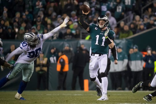 Eagles' Carson Wentz (11) throws downfield Sunday night against the Cowboys. The Eagles defeated the Cowboys 17-9.