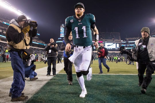 Eagles' Carson Wentz (11) heads towards the locker room after defeating the Dallas Cowboys 17-9 in December.
