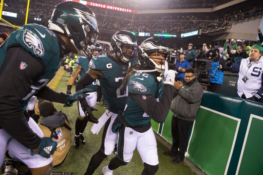 Eagles' Sidney Jones (22), Malcolm Jenkins (27), and Rasul Douglas (32) celebrate a fourth down stop which put Philadelphia in position to see out the Cowboys 17-9 Sunday night at Lincoln Financial Field.