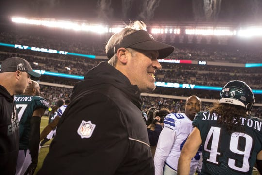 Eagles head coach Doug Pederson smiles as he heads to the locker room after defeating the Dallas Cowboys 17-9 Sunday night.