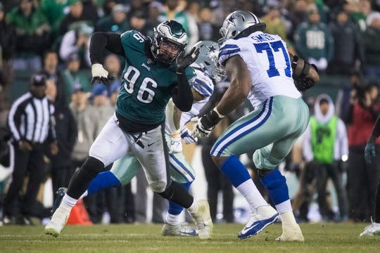 Eagles' Derek Barnett (96) looks for a way around Dallas' Tyron Smith Sunday night at Lincoln Financial Field. The Eagles defeated the Cowboys 17-9.