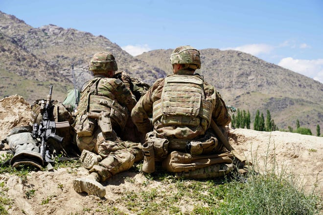 In this photo taken on June 6, 2019, US soldiers look out over hillsides during a visit of the commander of US and NATO forces in Afghanistan General Scott Miller at the Afghan National Army (ANA) checkpoint in Nerkh district of Wardak province