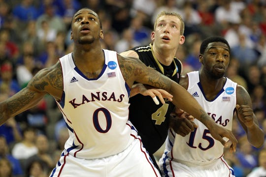 While at Purdue,  Robbie Hummel (center) scored 1,772 points. Here in a 2012 file photo, Hummel is shown with Thomas Robinson (left) and Elijah Johnson of the Kansas Jayhawks during the third round of the 2012 NCAA Men's Basketball Tournament at CenturyLink Center  in Omaha, Nebraska.  (Photo by Doug Pensinger/Getty Images)
