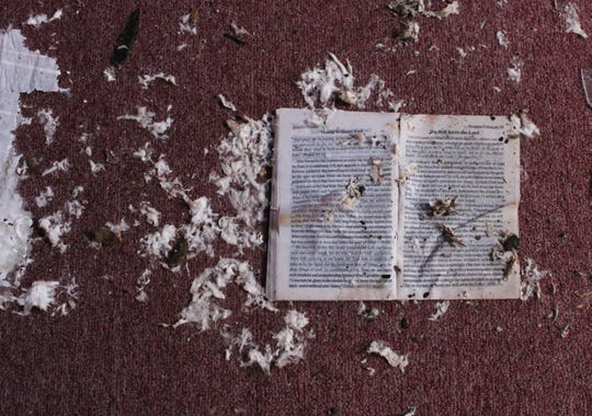 Pages ripped from a book, wet from rains, sit on the floor at Hope Baptist Church. The Alexandria church and school was extensively damaged Dec. 16 by an EF-3 tornado.