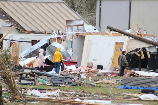 People look on Dec. 17 at what was left of Hope Baptist School, the day after an EF-3 tornado caused damage from DeRidder to Alexandria.