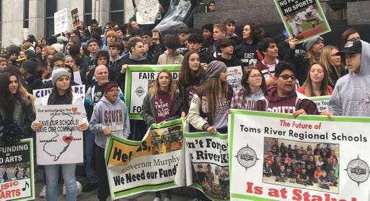 Toms River students and residents protest at the state capitol in Trenton for more funding.