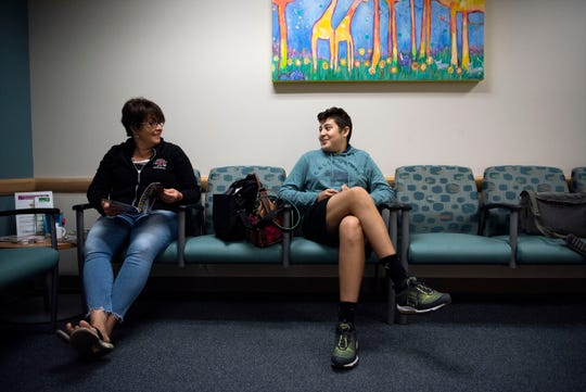 Carlos waits with his mom, Melanie Snodgrass, at Bronson Pediatric Hematology and Oncology before a chemotherapy appointment on Thursday, Sept, 26, 2019 in Kalamazoo, Mich.