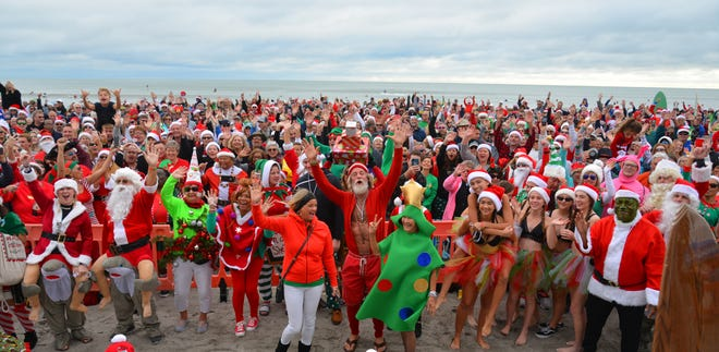 Thousands turned out to watch hundreds of Surfing Santas catch waves in Cocoa Beach for the 10th annual event in 2019.