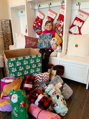 Berkley Wright shows off some of the blankets she collected in December to give to Brevard's homeless.