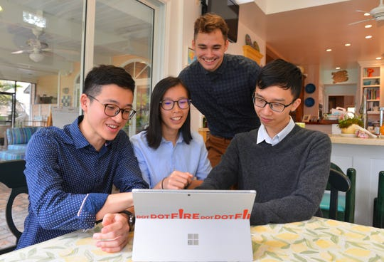 Three of the five co-founders of Dot Dot Fire  (seated, left to right) Franco Lam, Hilary Lok and Edison Chan with Nick Muckerman, project manager. Dot Dot Fire in partnership with The Foolproof Foundation, is creating a unique gaming experience that teaches skepticism with life lessons.