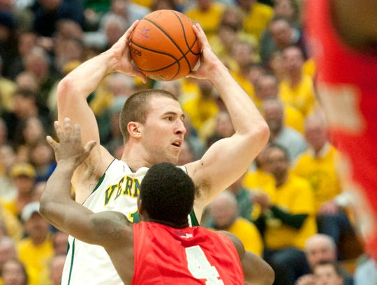 Vermont's Brian Voelkel looks to pass in this 2014 men's basketball game at Patrick Gym.