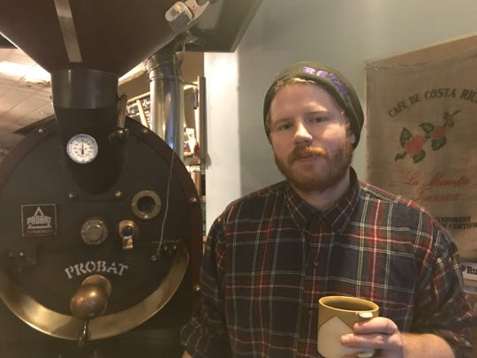 "Rob Maynard, 28, still roasting beans as of 7:30 a.m. Dec. 24, 2019, the day after Uncommon Grounds at 42 Church St. in Burlington shut its doors. He was bleary eyed from wrapping up his job at the now-defunct coffee shop and undertaking a ""massive build out"" in association with opening a new business in Essex."