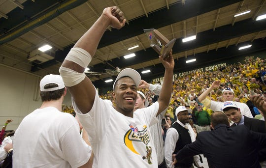 University of Vermont's Marqus Blakely accepts the MVP Award after the Catamounts won the 2010 America East Championship at Patrick Gym.